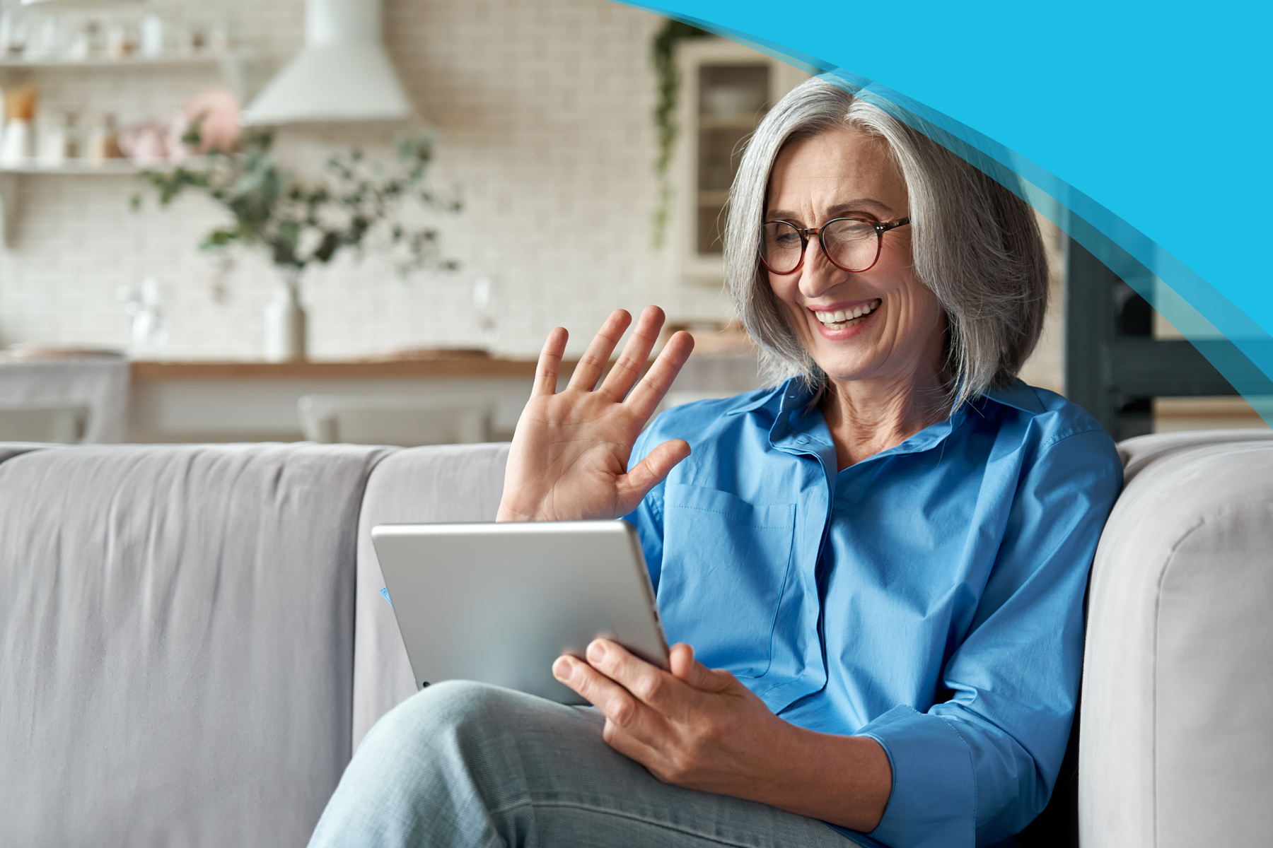 Mentor Program | Canadian Hard of Hearing Association - Older Woman using a tablet and laughing on a Couch