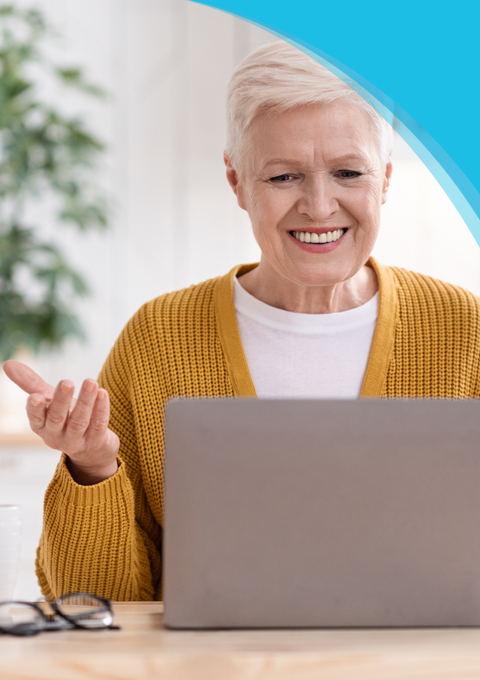 Code of Conduct | Canadian Hard Of Hearing Association - Woman smiling having conversation to a person on a laptop